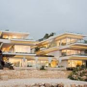 The home rises out of the stratified rock architecture, estate, home, house, property, real estate, residential area, resort, villa, gray