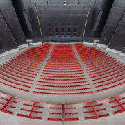 Red and black is a theme that runs arena, daylighting, line, red, sport venue, structure, gray, black