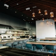 A high ceiling keeps the space open ceiling, interior design, restaurant, black