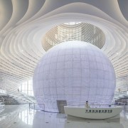 The eyeball-shaped auditorium within Tianjin Binhai Library is arch, architecture, building, ceiling, daylighting, daytime, line, structure, tourist attraction, gray