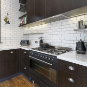 The rangehood sits perfectly flush with the cabinets cabinetry, countertop, cuisine classique, floor, flooring, hardwood, interior design, kitchen, kitchen stove, property, room, tile, wood flooring, black, white