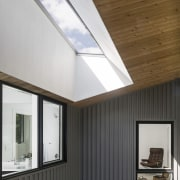 A skylight merges with the soffit - A architecture, ceiling, daylighting, home, house, interior design, lighting, real estate, roof, window, white, black