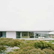 Large, floor to ceiling glass windows and doors architecture, facade, home, house, real estate, white