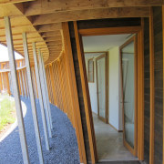 With sustainability and passive design rising high in beam, door, floor, handrail, home, house, real estate, stairs, structure, wall, window, wood, wood stain, brown
