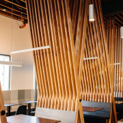 These beams  rise up like branches into architecture, ceiling, chair, furniture, interior design, table, wood, brown