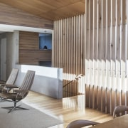 In this space, the concrete seems to balance architecture, ceiling, daylighting, floor, flooring, interior design, lobby, wall, wood, brown, gray