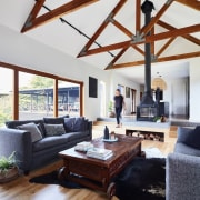 Exposed beams harken back to the home's past beam, ceiling, daylighting, floor, hardwood, home, house, interior design, living room, loft, room, wood, white
