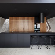 A large black counter leads the eye to architecture, cabinetry, countertop, furniture, interior design, kitchen, product design, table, black, gray
