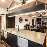 This home is stunning in so many ways. countertop, interior design, kitchen, loft, white, orange