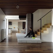 An extended landing runs through the body of architecture, ceiling, floor, flooring, hardwood, house, interior design, laminate flooring, living room, lobby, stairs, wood, wood flooring, gray, black