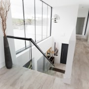Architect: 2020 ArchitectsPhotography by Reinis Babrovskis architecture, floor, flooring, handrail, home, house, interior design, laminate flooring, loft, property, real estate, stairs, wood flooring, white
