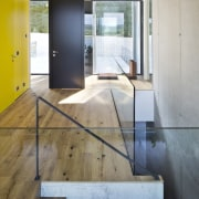 The stairway to the lower level is hewn architecture, floor, flooring, hardwood, house, interior design, laminate flooring, real estate, tile, wall, wood, wood flooring, gray