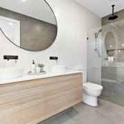 This large bathroom features a rain shower head bathroom, floor, flooring, interior design, product design, room, sink, tap, tile, gray