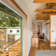 This hallway features an office along one wall architecture, ceiling, daylighting, floor, house, interior design, real estate, window, wood, brown