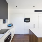 A dark grey splashback, white cabinets and counters architecture, countertop, interior design, kitchen, product design, white