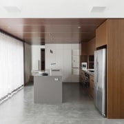 Wood features strongly in the kitchen - Wood cabinetry, floor, interior design, kitchen, product design, white