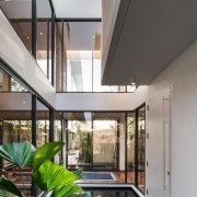 This open space is the perfect retreat from architecture, ceiling, condominium, courtyard, daylighting, estate, home, house, interior design, property, real estate, window, gray