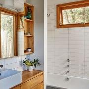 Architect: Kim Irons Photography by Nikole Ramsay bathroom, bathroom accessory, bathroom cabinet, cabinetry, countertop, floor, flooring, home, interior design, room, sink, tile, wall, window, wood, wood stain, gray