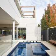 The pool is custom, perfectly suited to the apartment, architecture, daylighting, estate, home, house, property, real estate, residential area, swimming pool, white
