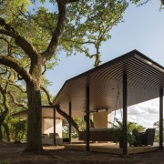 The roof line adjusts for the trees - architecture, cottage, farmhouse, home, house, pavilion, property, real estate, tree, brown