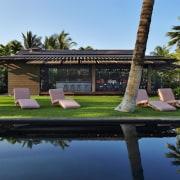 Architect: Olson KundigPhotography by Benjamin Benschneider arecales, cottage, estate, hacienda, house, landscape, leisure, palm tree, plant, property, real estate, reflection, resort, tree, villa, black