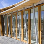 With sustainability and passive design rising high in door, facade, structure, window, gray