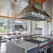Hardwood ceilings extend past this home's exterior walls countertop, interior design, kitchen, gray