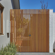 This slat fence is an interesting touch architecture, facade, fence, gate, picket fence, siding, wood, wood stain, brown, gray