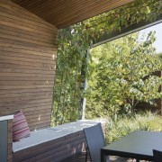 The wood panelling gives this sheltered outdoor room architecture, backyard, ceiling, daylighting, home, house, interior design, outdoor structure, porch, property, real estate, roof, shade, wall, window, wood, yard, brown