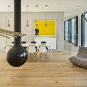Inside, everything is centred around the views - architecture, chair, floor, flooring, furniture, hardwood, house, interior design, laminate flooring, living room, loft, product design, structure, table, wood flooring, gray