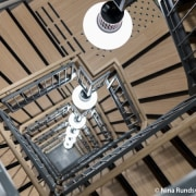 The building's spectacular central staircase. architecture, building, ceiling, clock tower, brown, black, gray