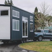 Build Tiny – Millennial automotive exterior, building, car, home, house, luxury vehicle, motor vehicle, property, sedan, shed, siding, trailer, transport, travel trailer, vehicle, white, gray