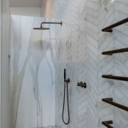 Shower stall and floor is in marble-look porcelain gray