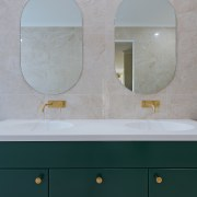 The vanity was extended to include two basins,