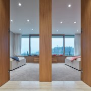 Twin timber doors open symmetrically on two guest