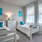 Bring in a pop of colour with a azure, bed, bed frame, bed sheet, bedding, bedroom, blue, boutique hotel, building, ceiling, curtain, daylighting, floor, furniture, home, house, interior design, mattress, mattress pad, nightstand, property, real estate, room, suite, table, turquoise, wall, window covering, window treatment, gray