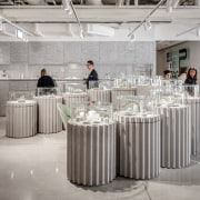 Photo by Michel Florent - Discover BIG's retail architecture, cylinder, design, furniture, table, gray