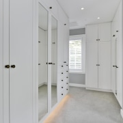 The expansive walk-in wardrobe offers a wealth of