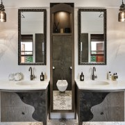A tall storage cabinet marks the centre of bathroom, bathroom accessory, home, interior design, room, sink, tap, gray
