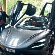 Morgan Cronin and his wife Michelle checking out automotive design, automotive exterior, car, land vehicle, luxury vehicle, mclaren automotive, mclaren mp4-12c, mclaren p1, motor vehicle, performance car, personal luxury car, sports car, supercar, vehicle, windshield, black