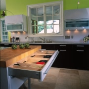 View of the kitchen's chopping block & draw countertop, interior design, kitchen, table, gray, black