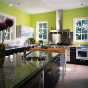 A colourful view of this magnificant kitchen countertop, interior design, kitchen, real estate, room, gray, black