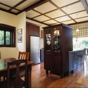 view  of the kitchen area showing the dining room, interior design, property, real estate, black
