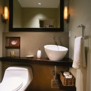 a mirror makes the powder room appear larger bathroom, bathroom accessory, home, interior design, plumbing fixture, room, sink, brown