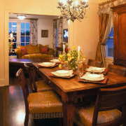 view of the formal dining area featuring antique ceiling, chair, dining room, furniture, home, interior design, living room, room, table, window, orange, brown, black