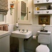 view of the traditional bathroom featuring freestanding vanity, bathroom, bathroom accessory, bidet, ceramic, floor, home, interior design, plumbing fixture, product design, room, sink, tap, toilet, toilet seat, gray, brown