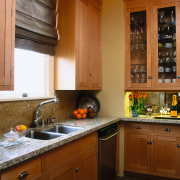 view of the kitchen featuring granite countertop, maple cabinetry, countertop, cuisine classique, home, interior design, kitchen, room, under cabinet lighting, window, brown