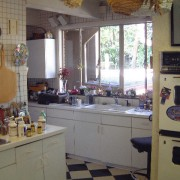 Before shot of the old cluttered kitchen countertop, flooring, home, home appliance, house, interior design, kitchen, real estate, room, gray