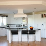 A view of this home hiding the facade cabinetry, ceiling, countertop, cuisine classique, floor, flooring, hardwood, interior design, kitchen, real estate, room, wood flooring, gray, white