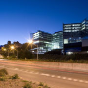 View of the exterior of the Owen G architecture, building, city, cityscape, commercial building, condominium, corporate headquarters, daytime, downtown, evening, headquarters, house, infrastructure, landmark, metropolis, metropolitan area, mixed use, night, real estate, residential area, road, sky, suburb, tree, urban area, blue